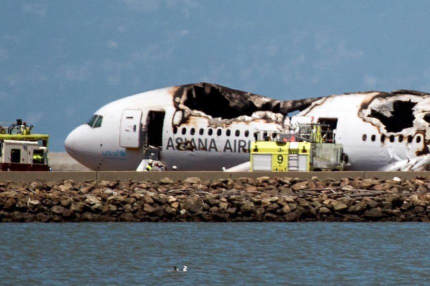 A Boeing 777 operated by Asiana Airlines sits on the runway after it crashed landed at San Francisco International Airport (SFO) on July 6, 2013. South Korea's Asiana Airlines on Monday, Nov 17, appealed against a government decision to suspend