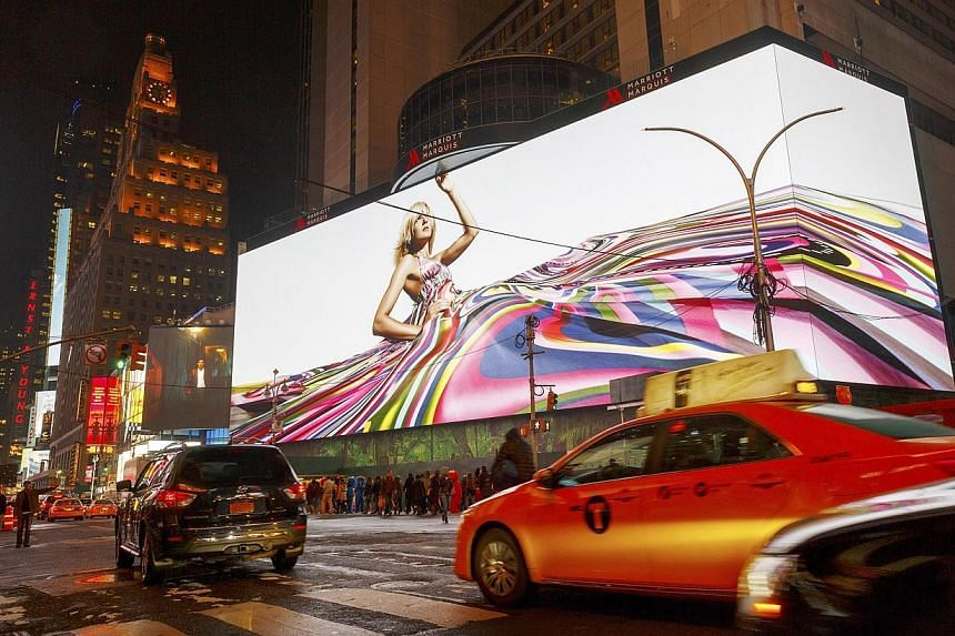 The world's largest high-definition digital display lights up for the first time in Times Square in New York on Nov 13, 2014. -- PHOTO: NYT