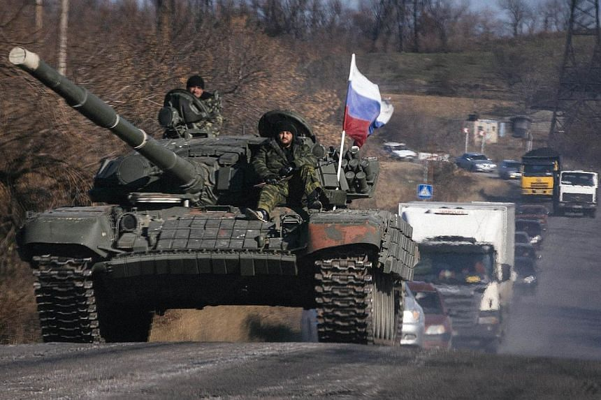 Pro-Russian separatists ride on top of a tank near the town of Krasnyi Luch in Lugansk region, eastern Ukraine, on Oct 28, 2014.President Vladimir Putin stuck to his guns as he refused to say where Moscow-backed Ukrainian separatists receive he