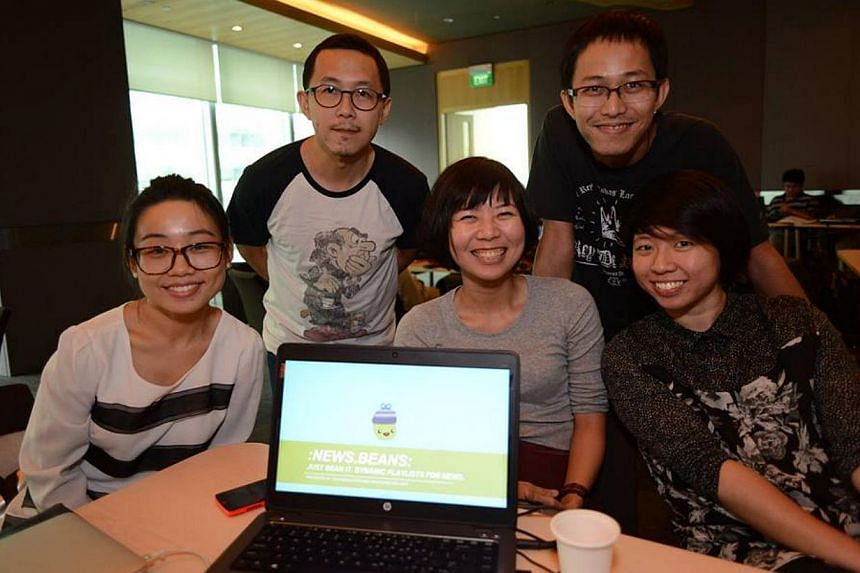 """The five-member team, including team leader Lim Huishan (middle) from Singapore Press Holdings that won the top prize at a digital media hackathon on Sunday for their personalised news app """"Beans"""". -- PHOTO: SPH"""