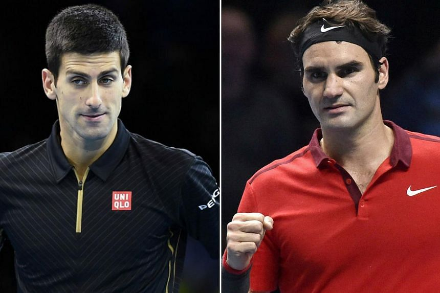 Tennis fans were in shock on Sunday at the news that Roger Federer (right) forfeited his ATP World Tour Finals final match against Novak Djokovic with a back injury. -- PHOTO: REUTERS