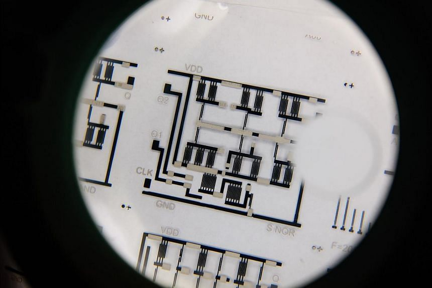 A low-cost complex electronic circuit printed on a transparent plastic sheet.-- PHOTO:NANYANG TECHNOLOGICAL UNIVERSITY