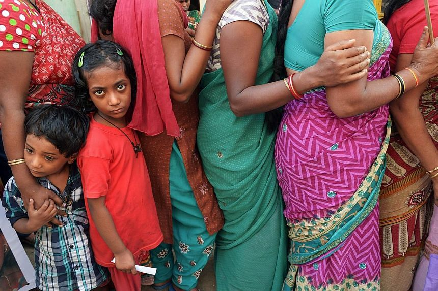 The children of Indian sex workers look on as they participate in a rally at the Sonagachi area of Kolkata on Nov 8, 2014.Forced to pick cotton, grow cannabis, prostitute themselves, fight wars or clean up after the wealthy - some 35.8 million