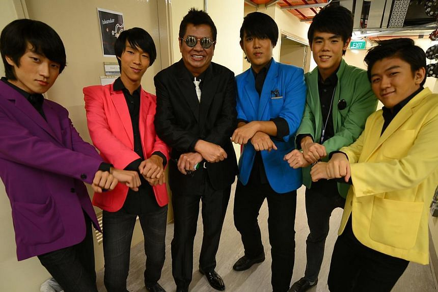 ChildAid artistic director Iskandar Ismail at the opening night in 2011; with teen rock band Dice, who performed in 2012. -- PHOTO: ST FILE