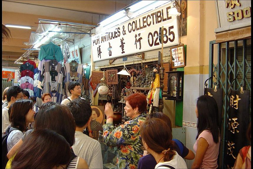 "Mrs Geraldene Lowe-Ismail leading a group on an ""Antiques – Best Price Lah!"" tour (above) in 2003; in a photo taken in 1984; and at the home of antique collector Percy Vatsaloo in 2004, which is one of the stops on her tours. -- PHOTO: TRISH HA"