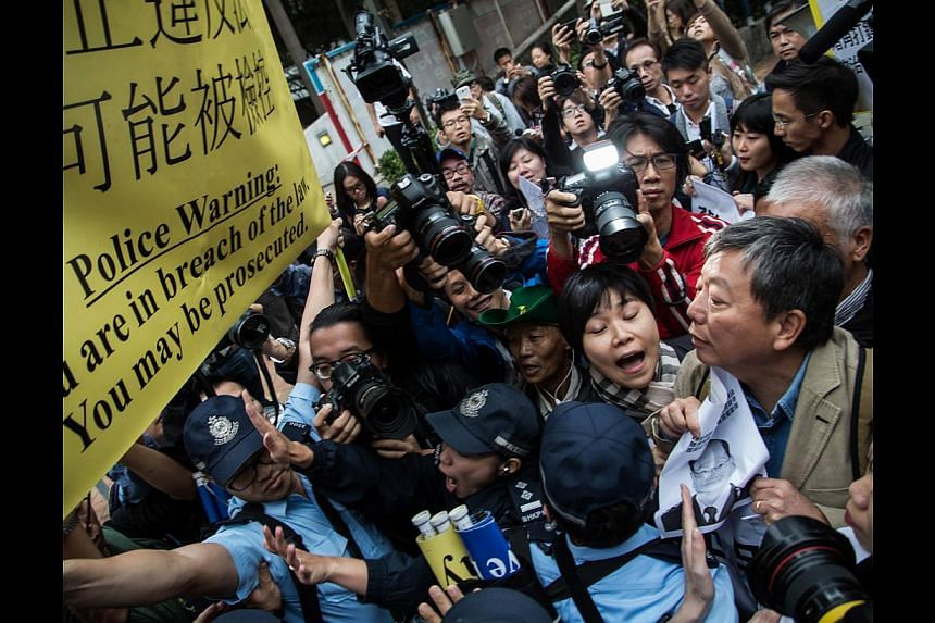 Protesters, seen here in a clash with police last week, have disrupted life in Hong Kong for almost two months now. Some political watchers think Beijing will tighten its grip on the territory after the dust settles.