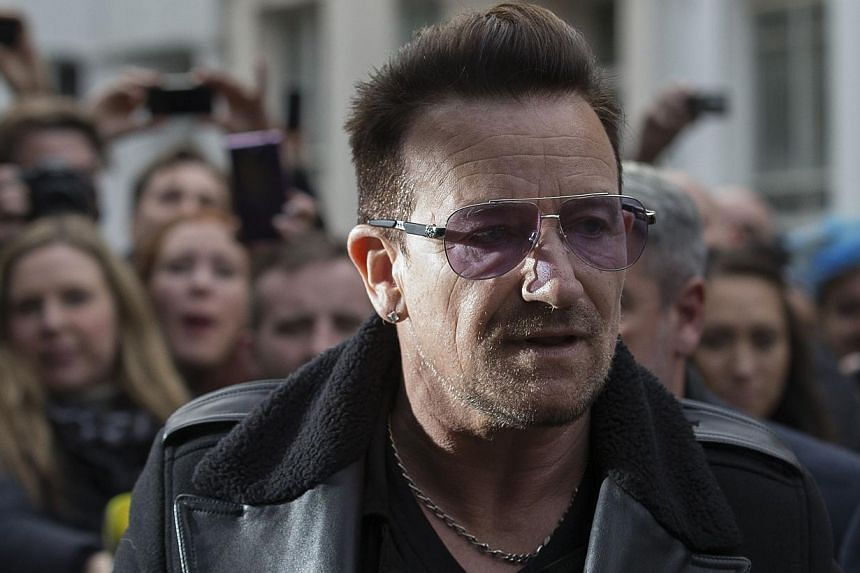 U2 frontman Bono arrives at a west London studio to record the new Band Aid 30 single on Nov 15, 2014. -- PHOTO: AFP