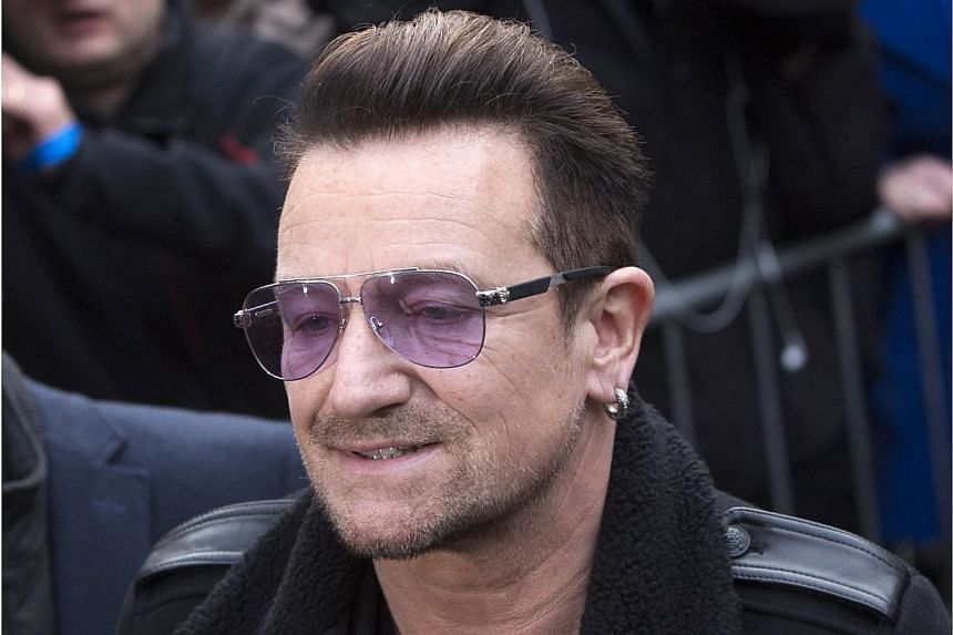 U2 frontman Bono will be getting surgery after injuring his arm in a fall from his bicycle in New York's Central Park, the band said on Sunday. -- PHOTO: REUTERS