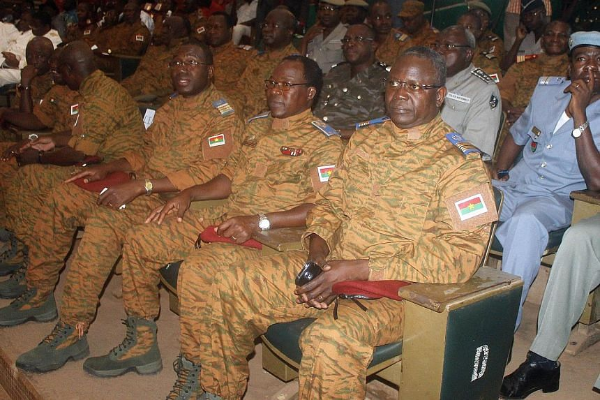 Burkina Faso's military leaders sit during a signature of a transition charter at the Maison du Peuple in Ouagadougou on Nov 16, 2014. -- PHOTO: AFP
