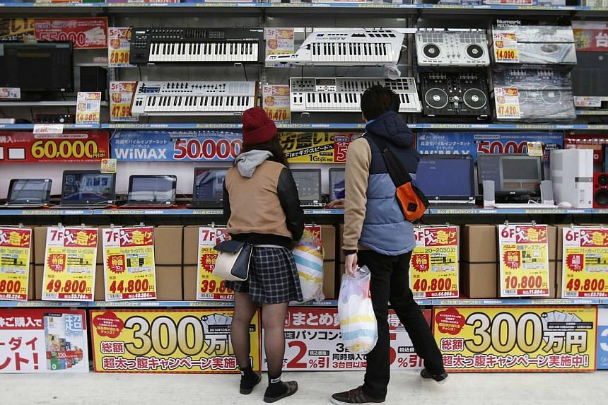 An electronics retail store in Tokyo on Nov 16, 2014. -- PHOTO: REUTERS