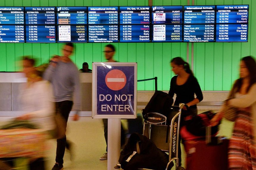Passengers arrive at Los Angeles International Airport in October 2014. -- PHOTO: AFP