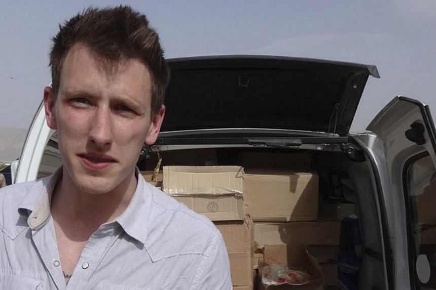 Abdul-Rahman (Peter) Kassig is pictured making a food delivery to refugees in Lebanon's Bekaa Valley in this May 2013 handout photo released by his family on Nov 16, 2014. -- PHOTO: REUTERS