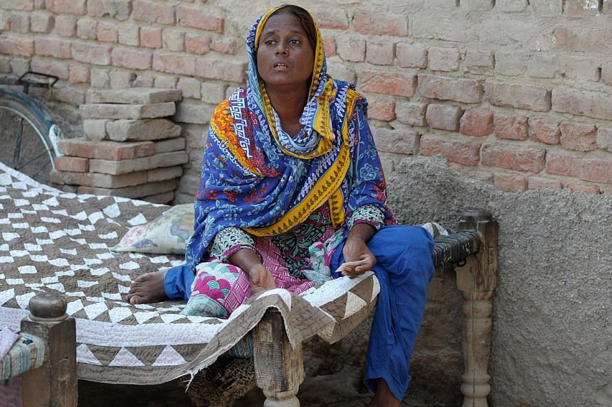 """Pakistani villager Razia Shaikh, one of countless mothers to suffer the misery of """"karo kari"""", gestures during an interview in Sukkur on Oct 18, 2014. -- PHOTO: AFP"""