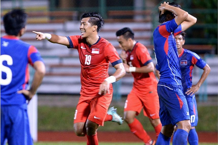 Singapore's Khariul Amri celebrates scoring his goal against Cambodia in a football friendly at Yishun Stadium on Nov 17, 2014.Singapore beat Cambodia 4-2 in a friendly match tonight for their second straight victory at Yishun Stadium, after ov