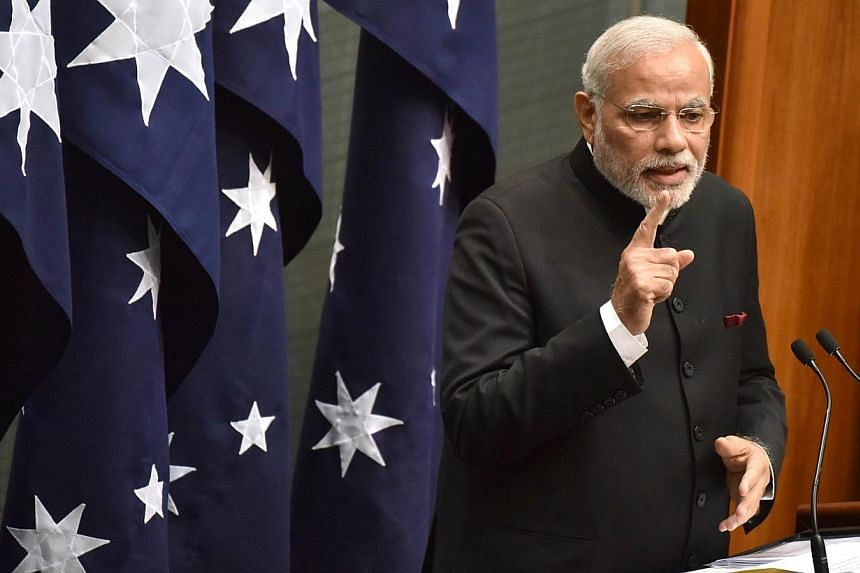 Indian Prime Minister Narendra Modi delivering a speech to members and senators at Parliament House in Canberra on Nov 18, 2014. -- PHOTO: AFP