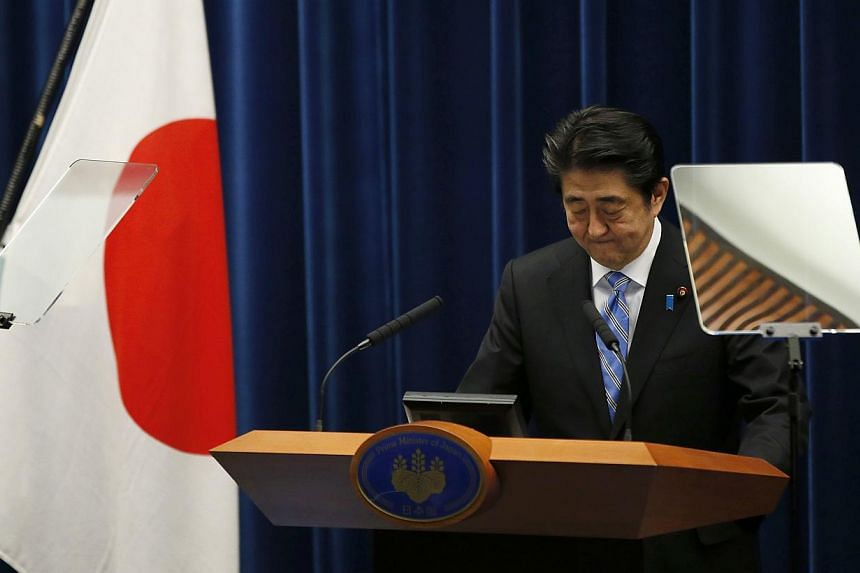 Japan's Prime Minister Shinzo Abe attends a news conference at his official residence in Tokyo on Nov 18, 2014. Japanese Prime Minister Shinzo Abe said on Tuesday he would delay a planned rise in the nation's sales tax to 10 per cent till April