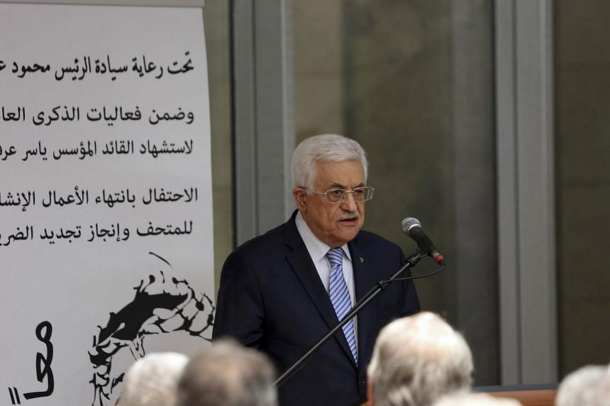 Palestinian President Mahmoud Abbas speaks at the opening of a museum of late Palestinian leader Yasser Arafat in the West Bank city of Ramallah on Nov 9, 2014. Palestinian President Mahmoud Abbas condemned an attack by two Palestinian men in a