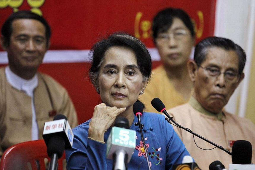 Myanmar's parliament speaker said on Tuesday the current junta-drafted constitution, which bars opposition leader Aung San Suu Kyi from becoming president, cannot be changed before elections in November 2015. -- PHOTO: REUTERS