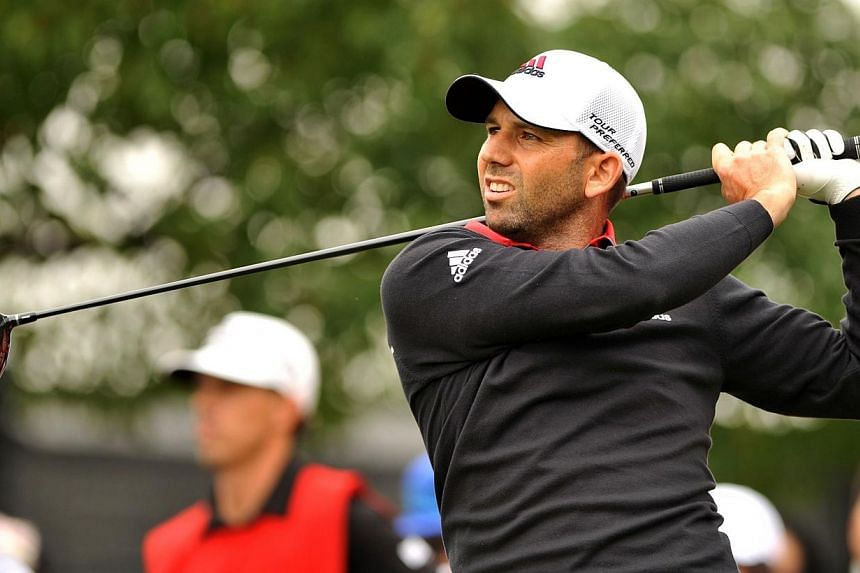 Sergio Garcia of Spain tees off at the 14th hole during the WGC-HSBC Champions Golf tournament in Shanghai on Nov 7, 2014.Golf's world No. 6 Sergio Garcia has roped in former French Open tennis champion Juan Carlos Ferrero as his caddie for his