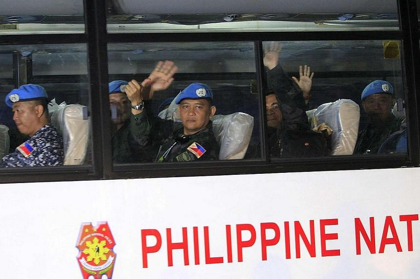 The Philippines' top health and military officials were under fire on Tuesday for visiting Filipino United Nations troops undergoing quarantine after serving in Ebola-ravaged Liberia. -- PHOTO: REUTERS