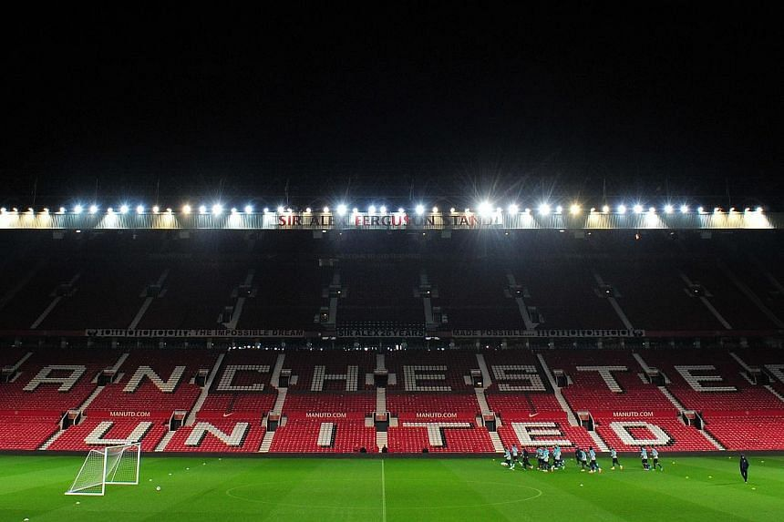 Portugal players take part in a training session at Old Trafford in Manchester, northwest England on Nov 17, 2014, ahead of the international friendly football match between Portugal and Argentina on Nov 18.English Premier League club Mancheste