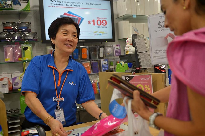 The seniors advocacy arm of the People's Action Party (PAP) wants to make it a legal requirement for companies to raise the re-enployment age from 65 to 67. -- PHOTO: ST FILE