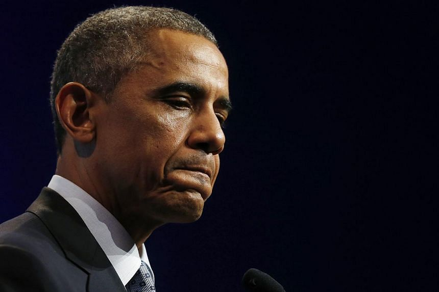US President Barack Obama listens to a question at a news conference at the end of the G-20 summit in Brisbane Nov 16, 2014. Mr Obama has ordered a review of how Washington can release American hostages as intelligence agencies investigated the invol