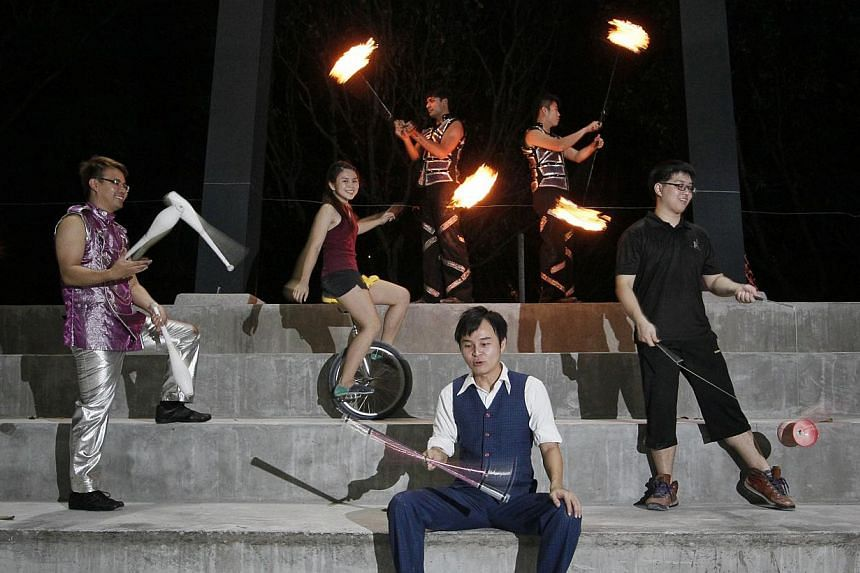 Social enterprise Circus in Motion founder Jay Che (seated in the centre) with circus members (from left) juggler Ernie Tan, unicyclist Ho Mei Qi, fire-twirling performers Ahmad Firdaus Ayoob Piperdy and Ethan Lee, as well as diabolo performer Edward