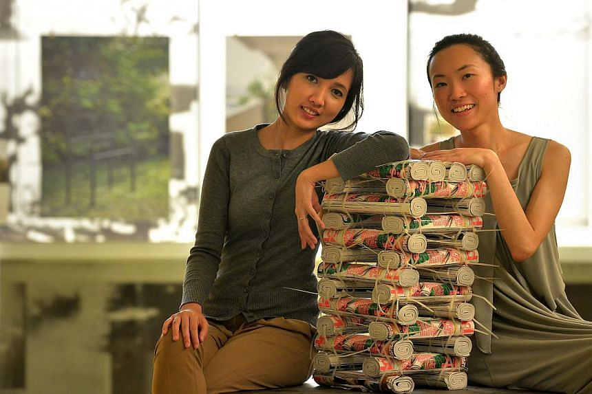 Mizah Rahman (left) and Jan Lim, co-founders of non-profit organisation, Participate in Design (P!D), with a stool made from magazines. The duo set up P!D in the belief that everyone has the right to shape their built environment. -- PHOTO: ST FILE&n