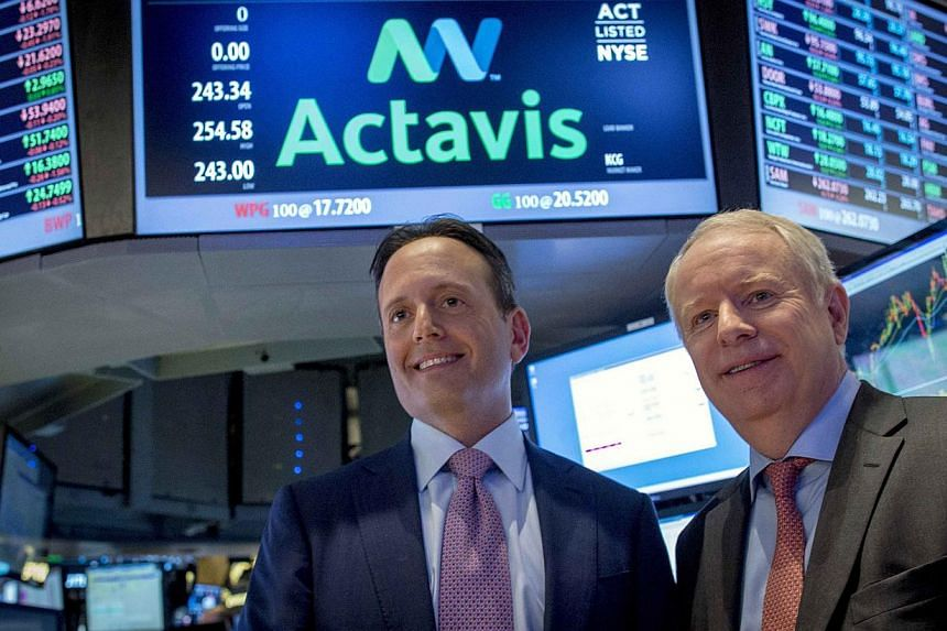 Actavis CEO Brenton Saunders (left) and Allergan CEO David Pyotton  on the floor of the New York Stock Exchange on Nov 17, 2014. Allergan on Monday accepted a US$66 billion (S$85.6 billion) takeover bid from Actavis, closing the door on a hostil