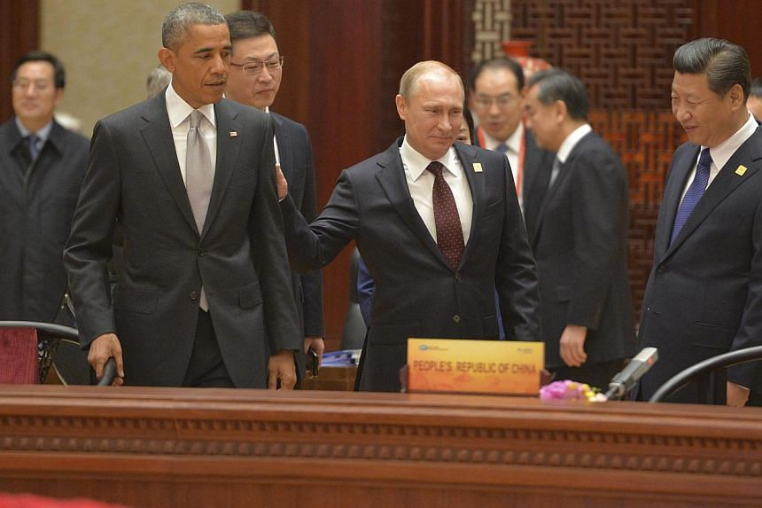 (From left) US President Barack Obama, Russian President Vladimir Putin and Chinese President Xi Jinping attend a plenary session during the Asia Pacific Economic Cooperation Summit in Beijing, on Nov 11, 2014. -- PHOTO: REUTERS