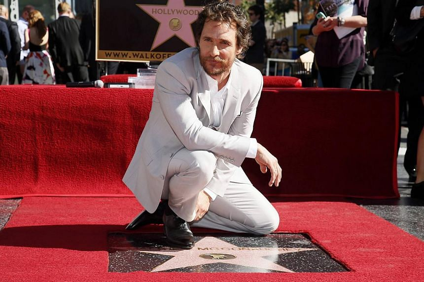 Actor Matthew McConaughey poses during a ceremony honoring him with the 2,534th star on the Hollywood Walk of Fame in Hollywood, California on Nov 17, 2014. -- PHOTO: REUTERS