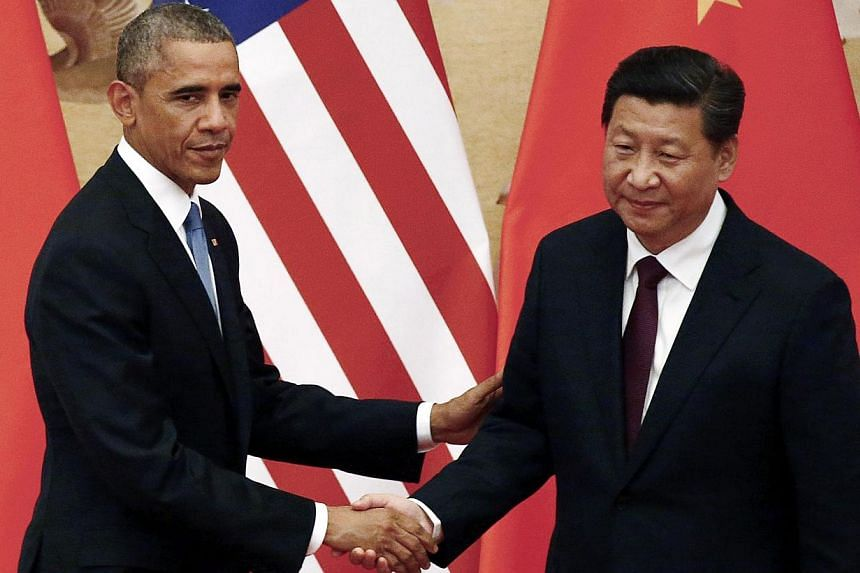 US President Barack Obama (left) and Chinese President Xi Jinping in Beijing on Nov 12, 2014. -- PHOTO: REUTERS