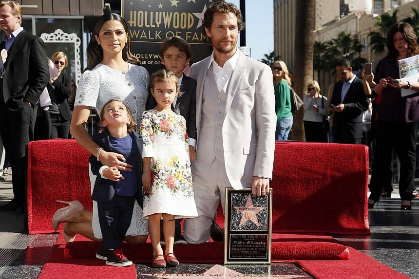 Actor Matthew McConaughey poses with his wife Camila Alves, sons Livingston (front left) and Levi (rear centre) and daughter Vida (front centre), during a ceremony honouring him with the 2,534th star on the Hollywood Walk of Fame in Hollywood, Califo