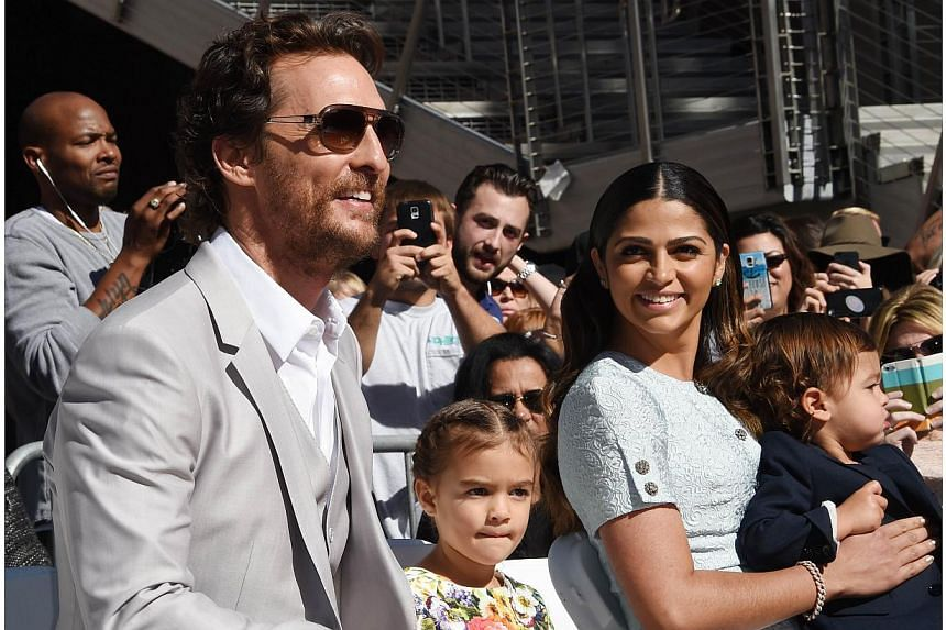 Actor Matthew McConaughey, his wife Camila Alves, and children Vida Alves McConaughey (centre) and Livingston Alves McConaughey (right) attend the ceremony honouring McConaughey with the 2,534th star on the Hollywood Walk of Fame in Hollywood, Califo