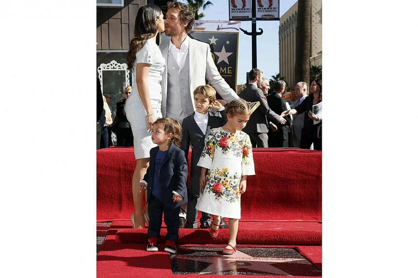 Actor Matthew McConaughey kisses his wife Camila Alves as he stands with his sons Livingston (front left) and Levi (centre), and daughter Vida (right) during a ceremony honouring him with the 2,534th star on the Hollywood Walk of Fame in Hollywood, C