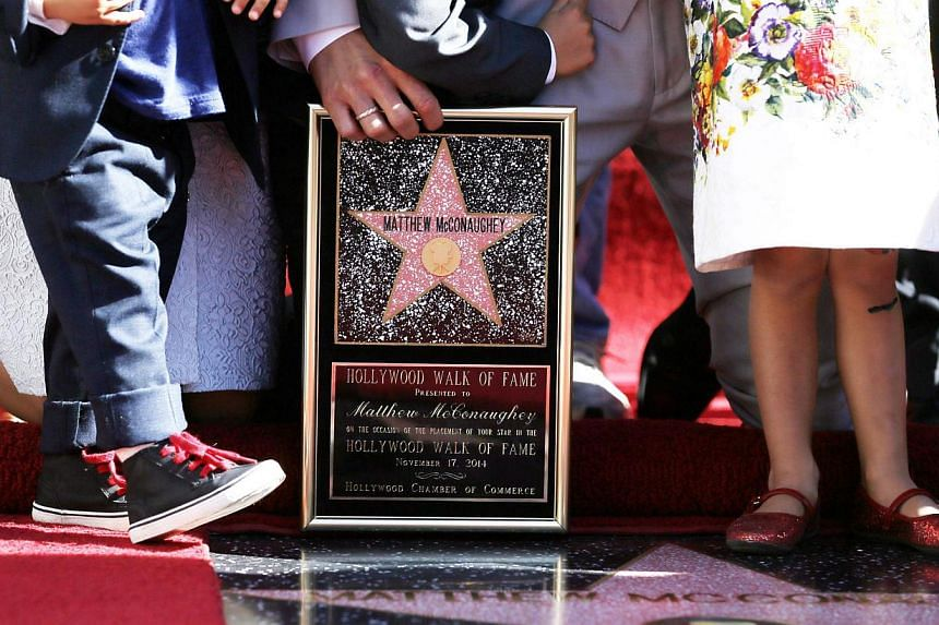 Actor Matthew McConaughey holds a plaque with a replica star on it as he stands with his sons Livingston (left) and Levi (centre), and daughter Vida (right) during a ceremony honouring him with the 2,534th star on the Hollywood Walk of Fame in Hollyw