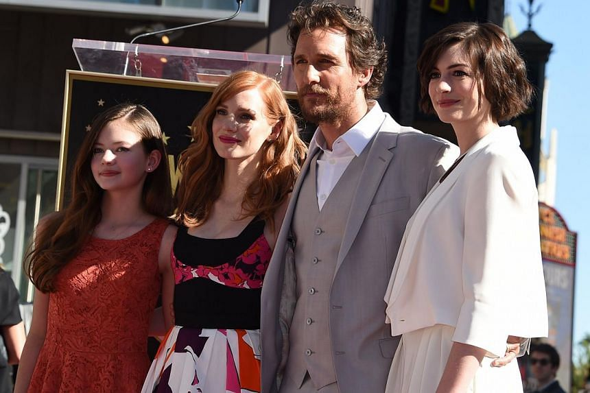 Actor Matthew McConaughey poses with actresses (from left) Mackenzie Foy, Jessica Chastain and Anne Hathaway during the ceremony honouring McConaughey with the 2,534th star on the Hollywood Walk of Fame in Hollywood, California, on Nov 17, 2014. -- P
