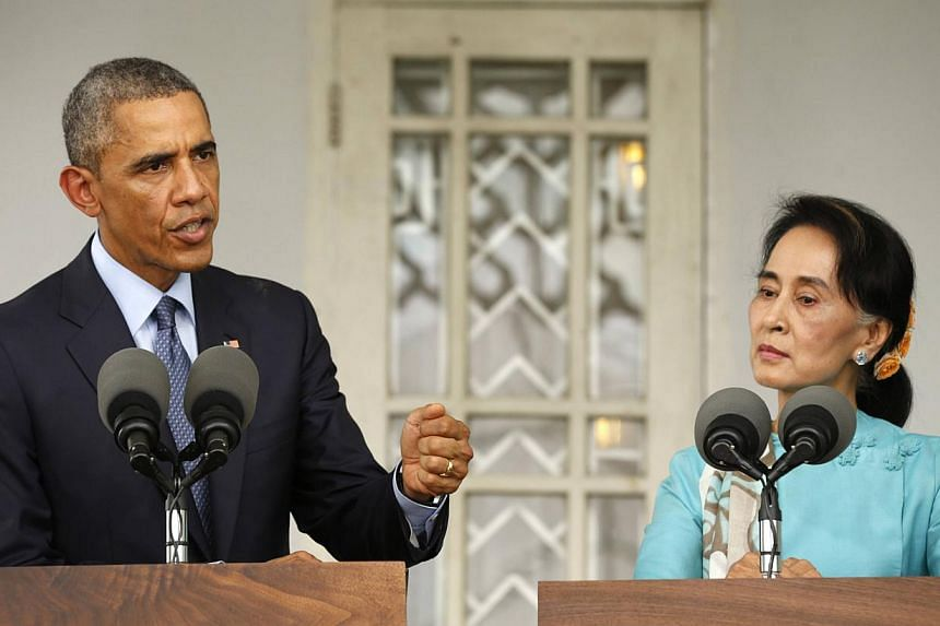US President Barack Obama and opposition politician Aung San Suu Kyi hold a press conference after their meeting at her residence in Yangon on Nov 14, 2014. Myanmar's army is against changing a junta-drafted Constitution that bars Ms Suu Kyi from bec