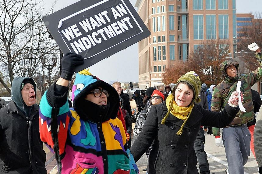 Protesters march in a peaceful protest on Nov 17, 2014 streets in Clayton, Missouri. The governor of the US state of Missouri declared a state of emergency on Monday and activated the National Guard ahead of a grand jury decision in the case of a bla
