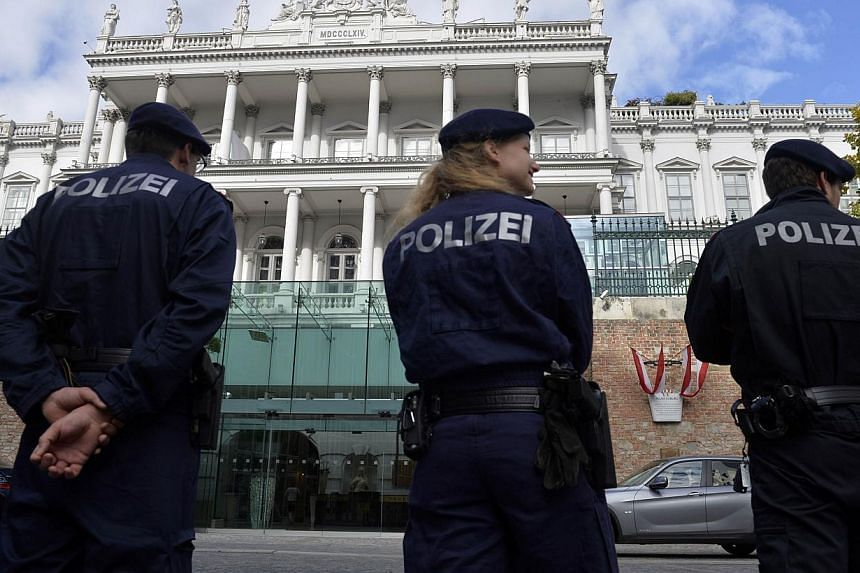 Police standing outside the Palais Coburg palace in Vienna, where the so-called EU 5+1 talks with Iran will take place on Oct 16, 2014 in this file picture. -- PHOTO: AFP