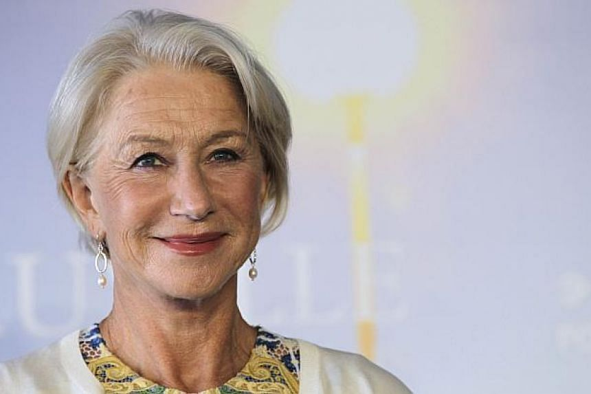 British actress Helen Mirren poses during a photocall to present the movie he hundred-foot journey in September during the 40th Deauville's US Film Festival in the French northwestern sea resort of Deauville, before becoming embroiled in Italian poli