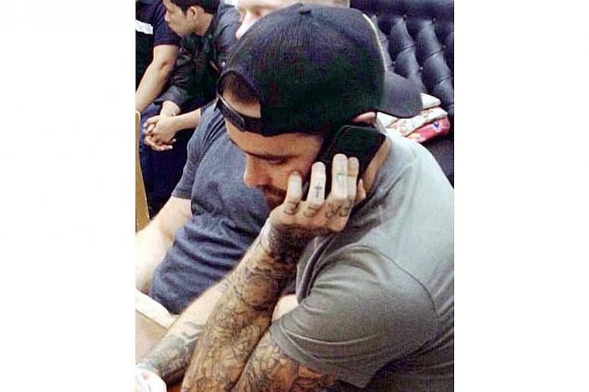 Heavily-tattooed, California Ryan Edward McPherson, seen in this image, has been interrogated by Thai police in the baby body parts case. -- PHOTO: THE NATION / ASIA NEWS NETWORK