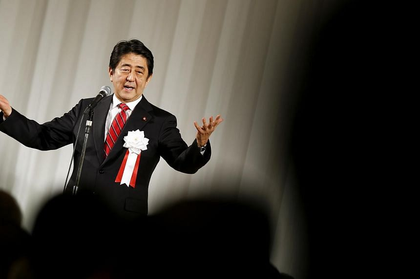 Japan's Prime Minister Shinzo Abe delivers a speech during a ceremony marking the 50th anniversary of the founding of the Komeito Party in Tokyo on Nov 17, 2014. Mr Abe is set on Tuesday to call a snap election, and seek voters' endorsement for more