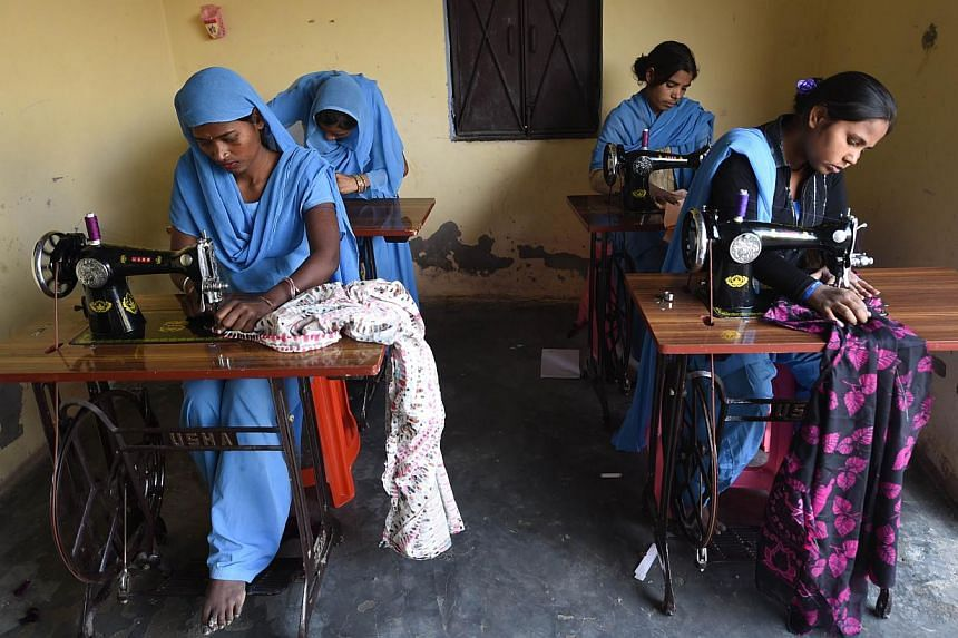 Indian former manual scavengers Preeti (left), Priyanka (2nd left), and Sonam (right) learn to sew at the Nai Disha (New Direction) vocational training centre run by Sulabh International in Nekpur village in Muradnagar, Ghaziabad, some 80 kms east of
