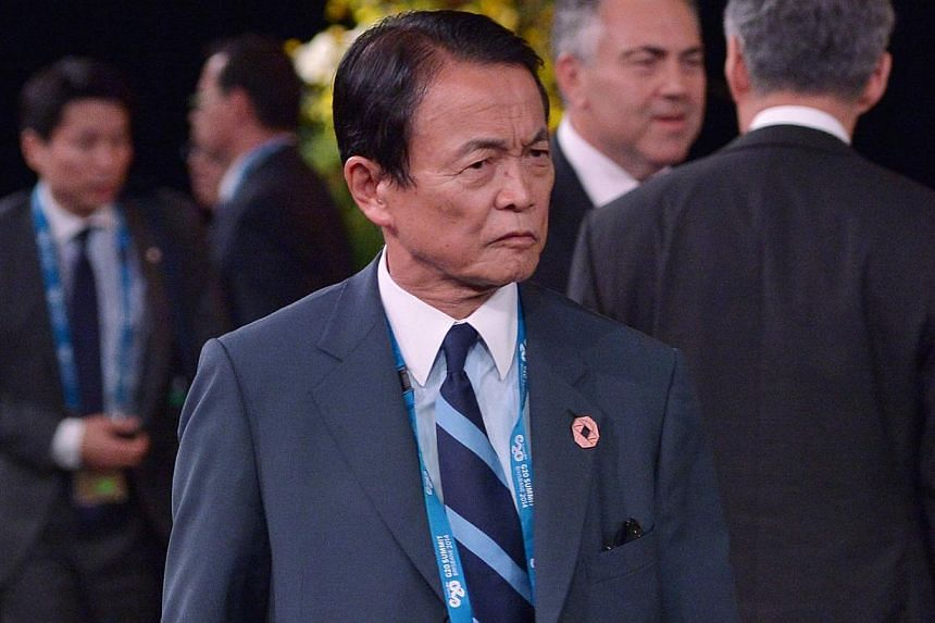 Japan's Deptuty Prime Minister and Finance Minister Taro Aso arriving for the welcome country performance at the Brisbane Convention and Exhibition Center on Nov 15, 2014 in Brisbane, Australia. Mr Aso said on Tuesday that raising the sales tax is un