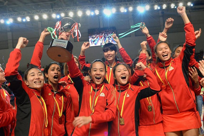 Members of Singapore's victorious netball team celebrate their second successive Asian title after defeating arch rivals Sri Lanka 59-41 at the Mission Foods Asian Netball Championshops on Sept 14, 2014.The team that will represent Singapore