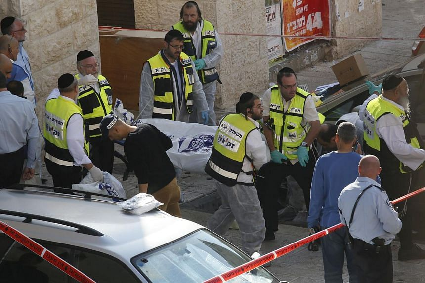Israeli police said on Tuesday that three of the people killed by Palestinian attackers in a Jerusalem synagogue were dual US-Israeli nationals and the fourth man held British and Israeli citizenship. -- PHOTO: AFP
