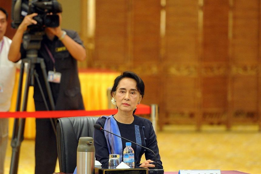 Opposition leader Aung San Suu Kyi before her meeting with Myanmar President Thein Sein (not pictured) at his resident office in Naypyitaw on Oct 31, 2014. Myanmar will not change its Constitution until after a general election late next year, compli