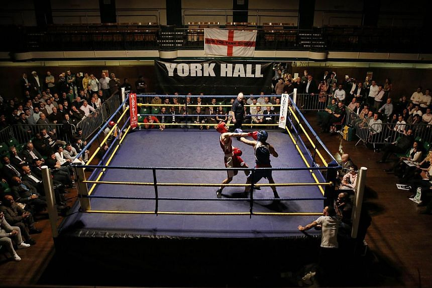 """A bout during the """"Brawl at the Hall"""" white-collar boxing event at York Hall in Bethnal Green, London.-- PHOTO: AFP"""